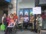 Katie and clowns, outside her new bank